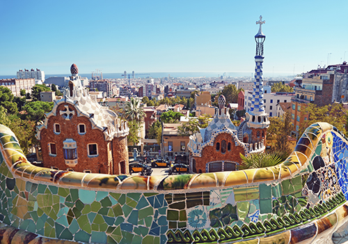 Park Guell in Barcelona. Park Guell was commissioned by Eusebi Güell and designed by Antonio Gaudí .